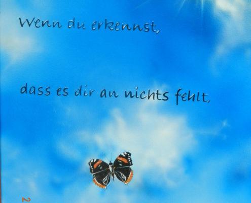 Schmetterling in der Luft mit Spruch